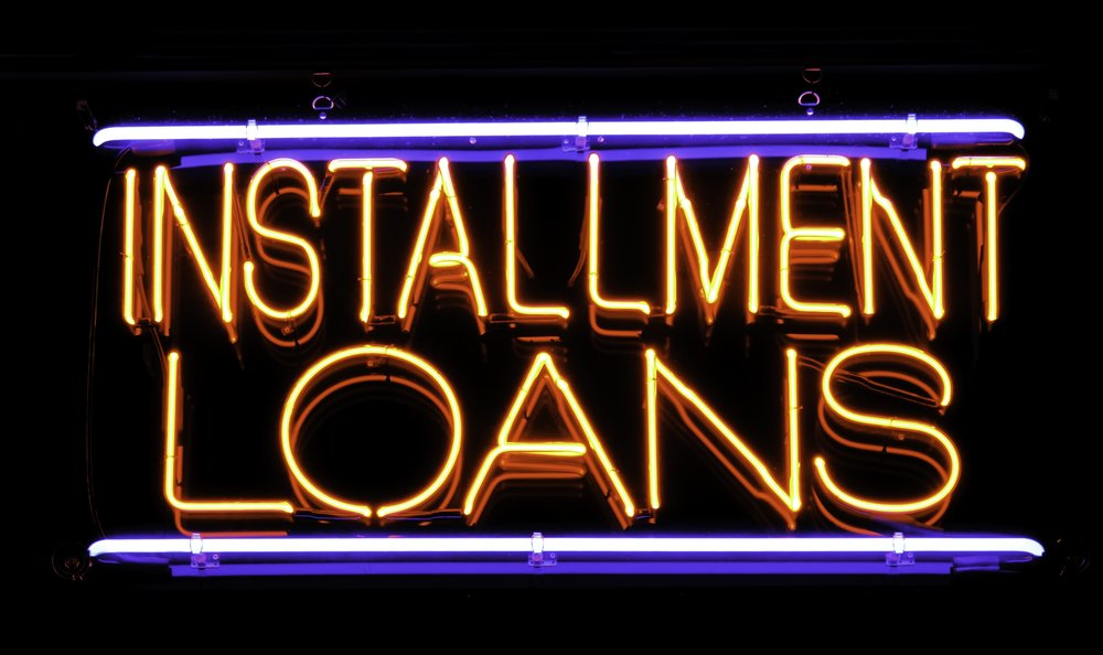 Neon sign in window of neighborhood loan shop